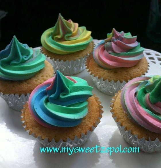 vanilla cupcakes with colorful frosting