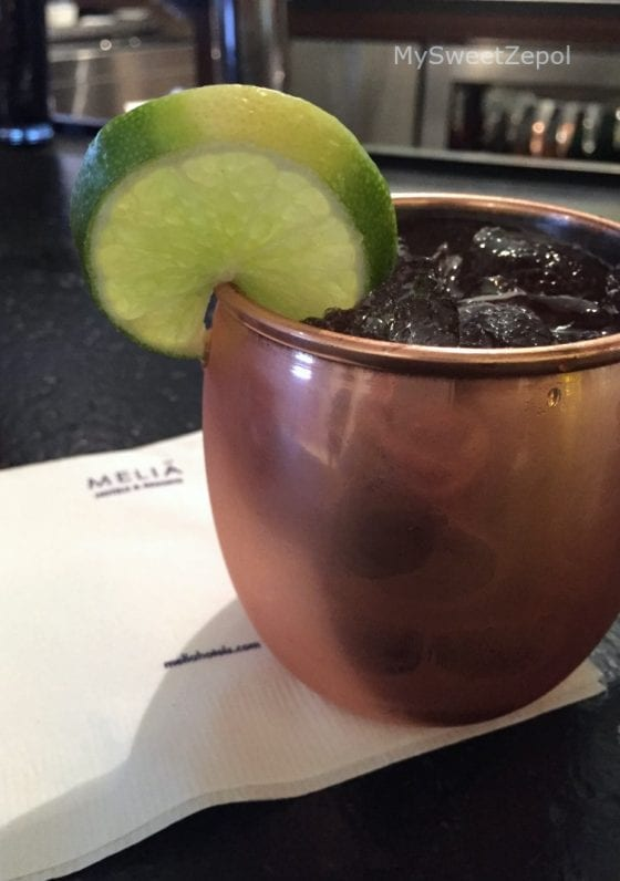 Meliá Mule consists of Knob Creek, Blackberry Brandy, ginger beer, and lavender simple syrup from 360 American Bistro and Bar
