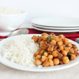 Chickpeas with bacon and ground meat served with rice