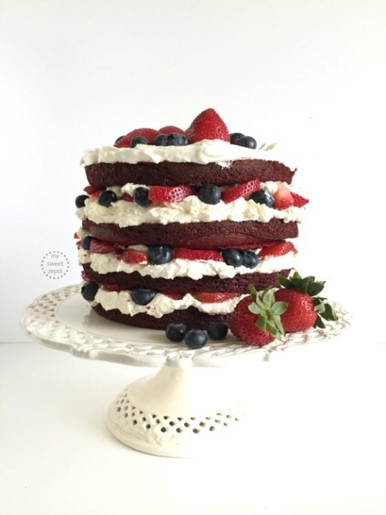 A Red Velvet, Berries and Cream Layer Cake has never been prettier. Make it and celebrate today, it's easier than it looks and tastes better than it looks too, if that's even possible! recipe found at mysweetzepol.com