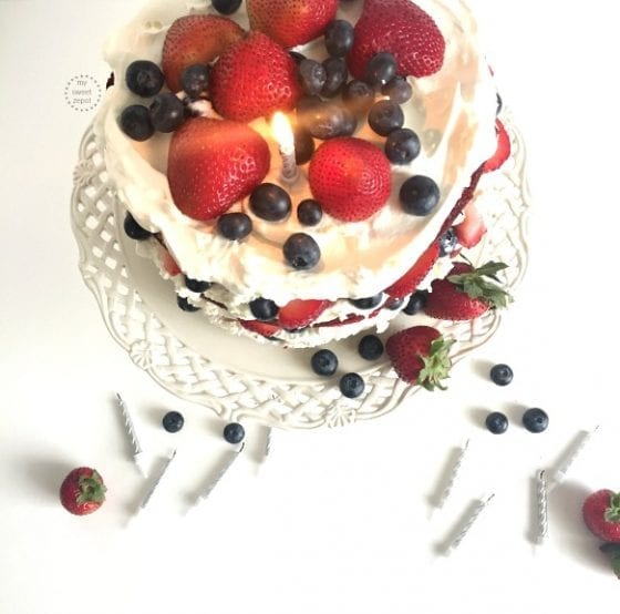A red velvet cake layers with a deliciously homemade cream cheese whip and fresh berries. Heaven in one plate! recipe found at mysweetzepol.com #birthdaycake