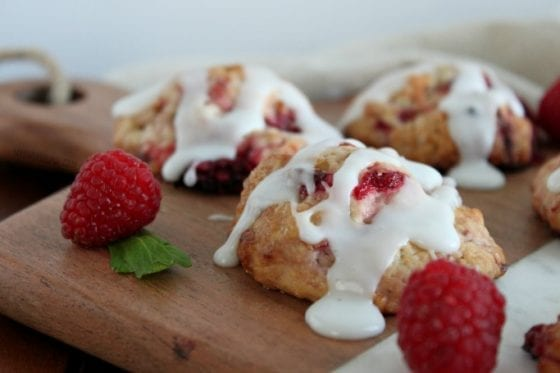 A vanilla glaze dripping over warm, soft raspberry biscuits are not just mouth watery but amazingly easy to make. Grab the recipe at mysweetzepol.com #foodie