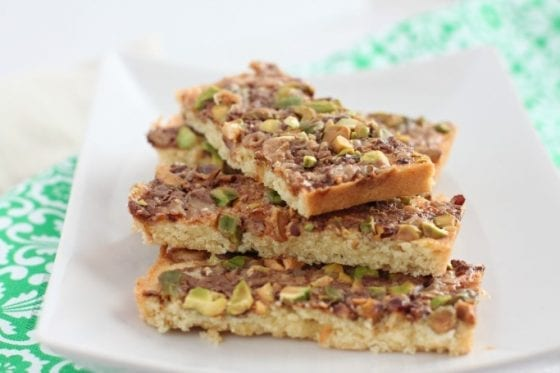 Grab this Pistachios Toffee Shortbread Bars recipe in mysweetzepol.com and make them asap. You'll love how easy they are to make and how amazing this shortbread bars tastes! #shortbread #cookierecipe