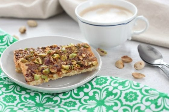 Grab this Pistachios Toffee Shortbread Bars recipe in mysweetzepol.com and make them asap. You'll love how easy they are to make and how amazing this shortbread bars tastes, specially with a warm cup of coffee! Oh, so good! #shortbread #cookierecipe