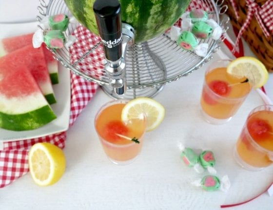 refreshing watermelon lemonade served through a watermelon beverage dispenser is the best way to enjoy any drink. #sponsored #CheddarsScratchKitchen