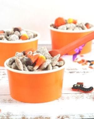 Spooky treats include our Witches Midnight Puppy Chow. Sweet, chocolaty with a hint of peanut butter and lots of candy corn. Perfect Halloween treat! #HalloweenTreatsWeek is as sweet as these puppy chow mix. Find more recipes at mysweetzepol.com