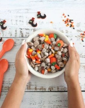 Witches Midnight Puppy Chow is fun and grown-ups and kids alike love them. Perfect for entertaining #HalloweenTreatsWeek