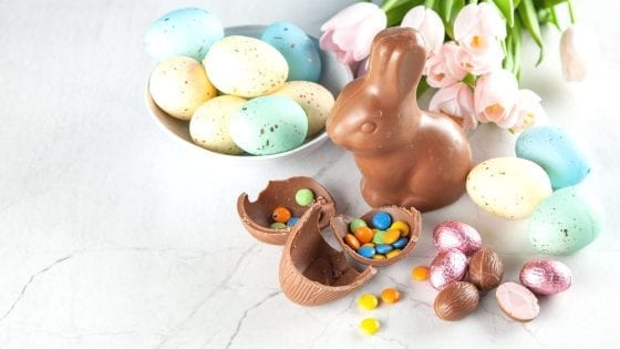 Chocolate Easter bunny with Easter candies and Easter Eggs