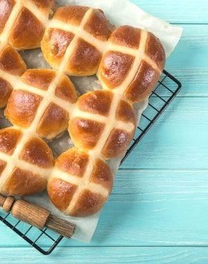 Cross-buns on a baking rack for Easter Sunday Dinner