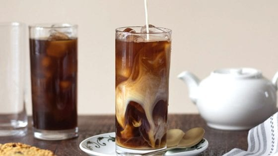 Cold brew coffee made in a French press with a splash of milk, ice coffee and milk