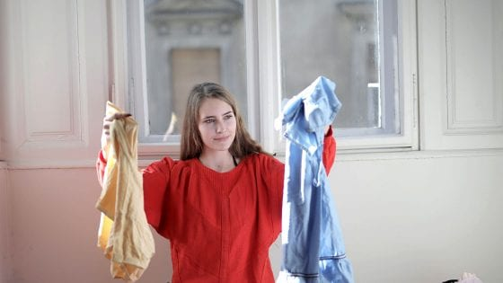 teenager sorting clothe for laundry chores