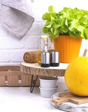 use stands to store salt and pepper, display a cute plant and linen, towel, set a basket on the side with a pumpkin, cutting board and cups