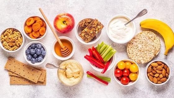 yogurt, apple, cherry tomatoes, honey, peppers, celery sticks, hummus, crackers, nuts, oats, banana, bars, healthy snacks ideas