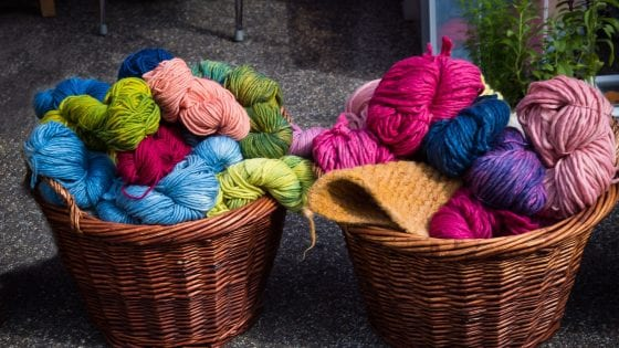 knitting yarns for chunky knit blankets, colorful knitting yarns in baskets
