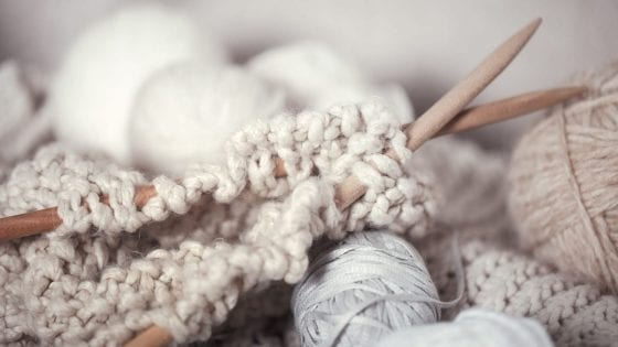 chunky yarn, chunky knit blanket, knitting wooden needles in white, cream and soft colors