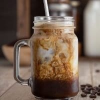 French Press Cold Brew Coffee with Milk served in a Mason Jar