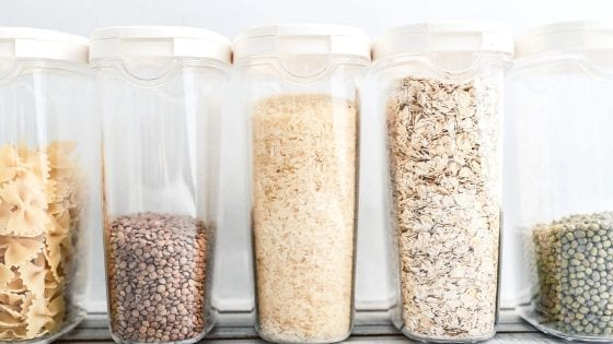 Kitchen storage containers with oatmeal, grains, beens, cereal, pasta