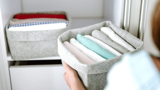 cube storage bin filled with baby - kids clothes, blankets, and towels