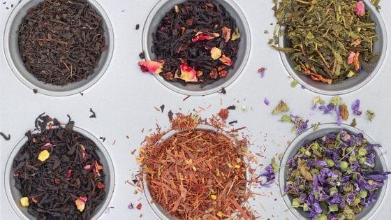 dried herbs in a cupcake or muffin tin